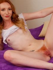 Redhead coed Katy Kiss exposes her pierced clit