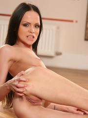Stunning babe Angellina fingering her tight pussy