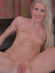 Blonde amateur Lexi Lou spreads her shaved pussy lips
