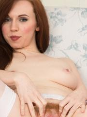Redhead beauty Vivi St. Claire spreads her fire-crotch for you