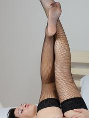 Cute brunette coed Tess wearing only her fishnet stockings