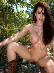 Katie Banks strips down to only her cowboy boots outside