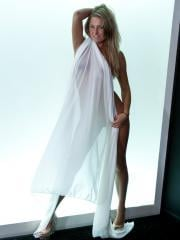 Kendra Rain gives you a hot tease in a white sheer sheet