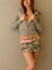 Redhead teen Kori Kitten teases in her short camo skirt