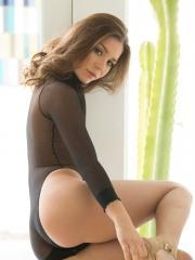 Brunette hottie Lily Chey strips out of her black bodysuit