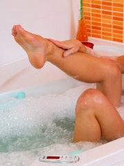 Pictures of Little Caprice playing with her pussy in the bath