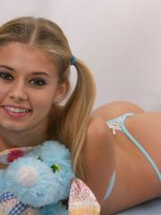 Teen with pigtails squeezes her perky tits together