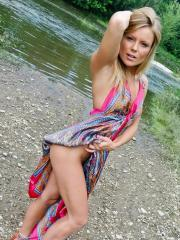 Stunning blonde Madden gives a sexy striptease down by the creek