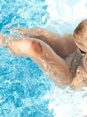 Blonde babe Madden strips and plays by the pool