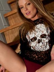 Beautiful blonde babe Madden teases in her skull shirt and socks