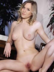 Aislin poses confidently in her dainty white lace panties