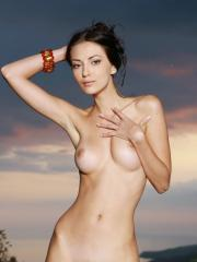Beautiful girl Anna AJ flaunts her tight body in the twilight