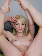Gorgeous blonde girl Nika N gets totally nude and shows you her tight pussy