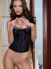 Beautiful girl Anna AJ spreads her legs in a black corset