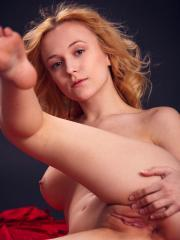 Blonde beauty Aislin strips out of her sexy red dress