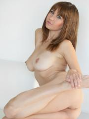 Busty hottie Chrissy Marie strips nude young, wild and free