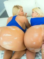 Curvy babes Julie Cash and Karen Fisher bounce their booties on a lucky cock