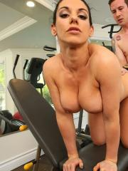 Busty girl Bella Reese fucks her personal trainer in the gym