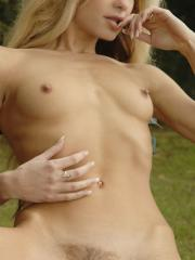 Blonde model Mia shows off her skinny body outside