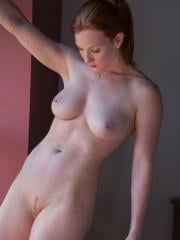 Busty redhead Amelia shows you her sexy curved body