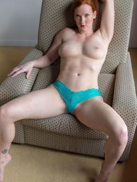 Redhead model Amelia shows topless