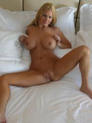 Blonde babe Allie strips and masturbates for you in bed