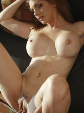 Busty redhead Lilith Lust puts out on the couch