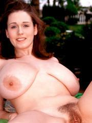 Busty girl Nicole Peters gives you her hot curvy body outside