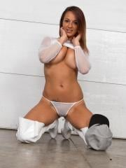 Nikki Sims teases for you in a white mesh top