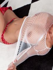 Nikki puts on her white mesh and red boots to roll around on the floor for you