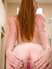 Naughty redhead Alex Tanner pleasures her throbbing pink pussy