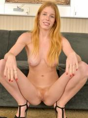 Perky tit newcomer proves that she is a natural redhead