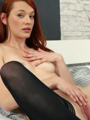 Beautiful redhead Amber Cute fingers her wet tender pussy