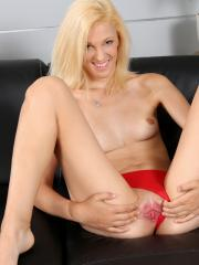 Blonde girl Ulpiana fingers her tight pussy on the couch