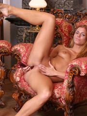Horny coed Chrissy Fox works the stripper pole and masturbates