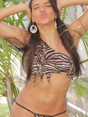 Vivi Spice is a jungle hottie as this latina teen strips and shows her tight body