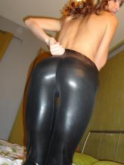 Gina Gerson in tight black pants and heels