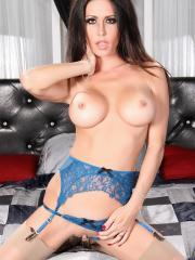 Busty brunette Jessica Jaymes spreads her pink pussy in blue and white lingerie