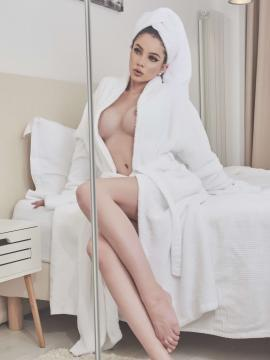 Renne Cross teasing in a robe and lingerie