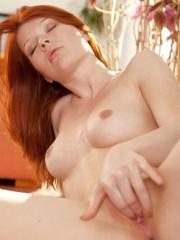 Fiery redhead Mia Solis slides down her panties to fondle her tight pussy