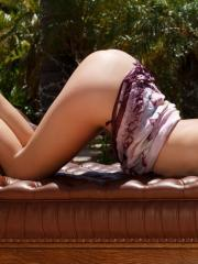 Beautiful model Malena Morgan strips naked and fingers her pussy by the pool