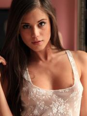 Caprice strips out of her white lingerie and fingers her wet pussy