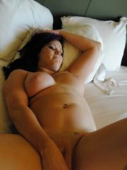 Chubby girlfriend gets naked and plays with her wet pussy in bed