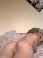 Skinny girlfriend strips naked and spreads her wet pussy