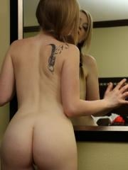Teen hottie Mandy Roe strips in front of the mirror in her pigtails