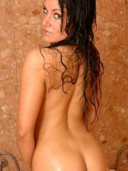 Busty babe Sweet Krissy gets all wet for you in the shower