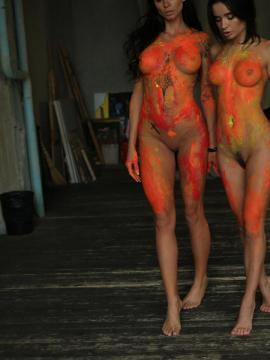 Two hot babes get messy with the paint