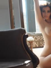 Summer St Claire strips down to her thong to show off her long legs and round boobs