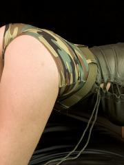 Blonde babe Mia strips out of her sexy camo
