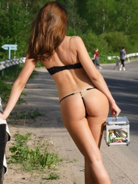 Sweet Lilya shows her round ass outside